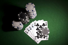 Poker cards on green background Royalty Free Stock Photography