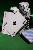 Poker cards on green background Stock Photography