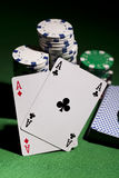 Poker cards on green background Royalty Free Stock Image