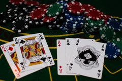 Poker cards in green background stock image