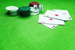 Poker cards on a green table with dice and chips stock photography
