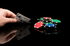 Poker cards with hand Stock Images