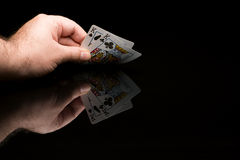 Poker cards with hand Stock Photos