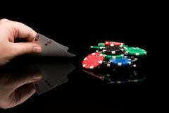 Poker cards with hand Stock Photography