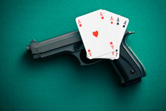 Poker cards and handgun Stock Photography