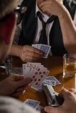 Poker cards and handgun Stock Photos