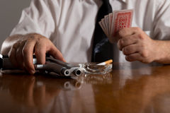 Poker cards and handgun Royalty Free Stock Photo