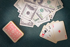 Poker cards with money Stock Photography