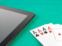 Poker cards near digital tablet pc, poker online Royalty Free Stock Photography