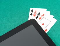 Poker cards near digital tablet pc, poker online Royalty Free Stock Photos