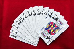 The poker cards on red background Stock Photography