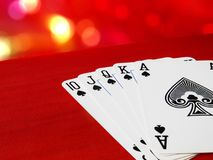 Poker cards on red material, Royal flush hand. Space for text. Game concept for casino backgrounds, invitation cards, web backdrops, gambling banner Stock Photos