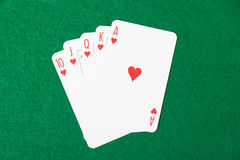 Poker cards with royal flush combination on green cloth Stock Image