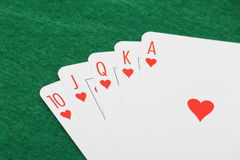 Poker cards with royal flush combination on green table Royalty Free Stock Photography