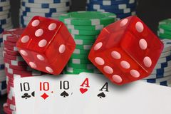 Poker cards showing full house and chips, jetons and red dices. Stock photo royalty free stock image