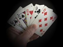 Poker cards showing Straight hand isolated on black background with vignette effect Royalty Free Stock Photos