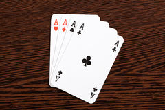 Poker cards on table Stock Photos