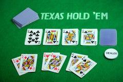 Poker cards Texas Hold em. Poker cards on green poker cloth. Texas Hold`em Stock Photos