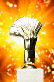 Poker cards trophy against shiny background Royalty Free Stock Image