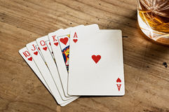 Poker cards and whisky glass Royalty Free Stock Photography