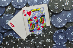 Poker cards. Wining cards with some coins Stock Photo