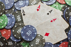 Poker cards. Wining cards with some coins Royalty Free Stock Image