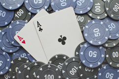 Poker cards. Wining cards with some coins Stock Photos