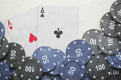 Poker cards. Wining cards with some coins Royalty Free Stock Photography