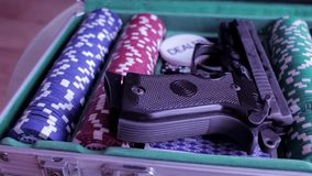 Poker case with gun. CSI Cards stock video footage