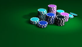 Poker And Casino Chips Background. Gambling casino chips stacked on green table. Great background for poker magazines, banners, webpages, flyers, etc Stock Images