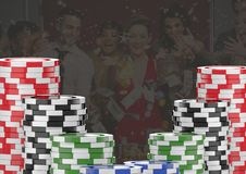 Poker casino chips in front of gambling people Stock Photos