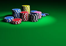 Poker Casino Chips On Green Table Royalty Free Stock Image