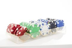 Poker coins on isolated white studio background. Closeup photo. Clipping path. Easy to use. White background. Cutout cut. Poker casino coins token tokens on stock photo