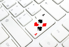 Poker or Casino online game concept. Key on white keyboard. Poker or Casino online game concept. Spades hearts diamonds clubs key on white keyboard Stock Photography