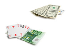 Poker challenge. Full house consisted of cards backed up by 100 euros against full house consisted of dollar bills backed up by a Joker Royalty Free Stock Photography