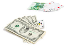 Poker challenge. Full house consisted of dollar bills backed up by a Joker against full house consisted of cards backed up by 100 euros Royalty Free Stock Photos