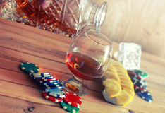 Poker chip and brandy glass Royalty Free Stock Image
