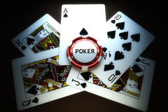 Poker chip with cards. With a dark background Royalty Free Stock Photography