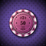 Poker chip nominal fifty, on card symbol background.  Royalty Free Stock Photography