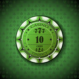 Poker chip nominal ten, on card symbol background.  Stock Photography