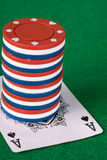 Poker chip stack. Stack of poker chips with and ace royalty free stock photo