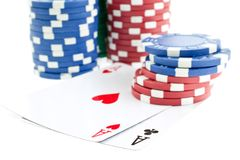 Poker chip stacks and two aces Royalty Free Stock Photos