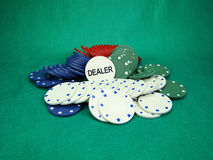 Poker chips. Spread on a green background stock photo