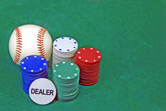 Poker chips. On a green table and a baseball ball royalty free stock images