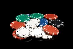 Poker chips. Set of poker chips on a black background Stock Photos