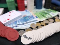 Poker chips. Details of poker chips, playing cards and money stock image