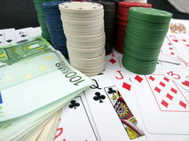 Poker chips. Details of poker chips, playing cards and money stock images