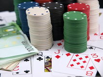 Poker chips. Details of poker chips, playing cards and money royalty free stock images
