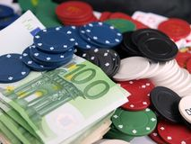 Poker chips. Details of poker chips and money royalty free stock photos