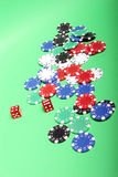 Poker chips. Different color poker chips and dices royalty free stock photo
